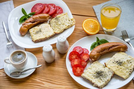 Stock image of hearty breakfast, coffee and orange juice. Top view
