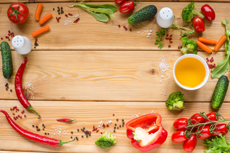 Table with fresh vegetables, tomato, pepper, cucumber, carrot, space for text. Stock Photo
