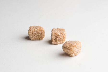 Pure Sugar Cane Cubes on a white background