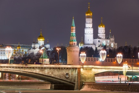 Moscow Kremlin in winter night. Vodovzvodnaya (water pumping) tower (front) Grand Kremlin Palace, Ivan the Great bell tower, Spassky (Saviors) tower and Archangel cathedral (background).