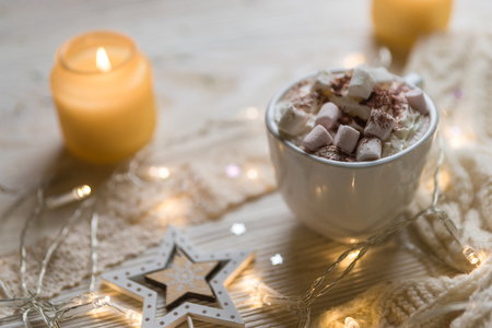 Whuite cup of hot Chocolate drink with Marshmallows and cinnamon on rustic wooden background. Winter time. Holiday concept, Selective focus