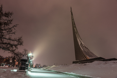 The Monument to the Conquerors of Space was built in 1964 to celebrate the achievements of the Soviet aerospace industry, Moscow, Russia, winter, night.