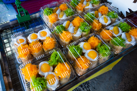 Cooking fresh Thai snack crispy pancakes (khanom buang in Thai language). This traditional dessert is among the most popular in street food Thailand.