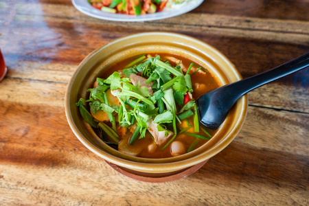 Tom Yum Gai or spicy tom yum soup with chicken - Authentic Thai style food. With ingredients: lemongrass, galangal, kaffir lime leaves, fresh chilies, and green onion. Stock Photo - 124464453