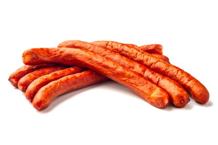 Delicious smoked sausages with vegetables on white background Stok Fotoğraf