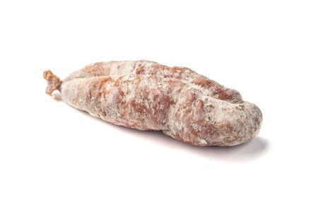 Delicious dry sausage on a white background.