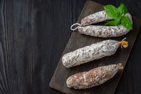 Three Grilled sausage of a different kind on a black background Фото со стока