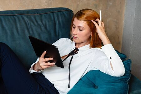 Business woman relaxing at home after working laying on the sofa.