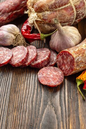 Salami,sausage. Meat antipasto platter on wooden table. Low angle view