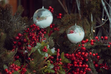 Christmas outdoor background with fir tree branches, decorations with glass balls. 写真素材
