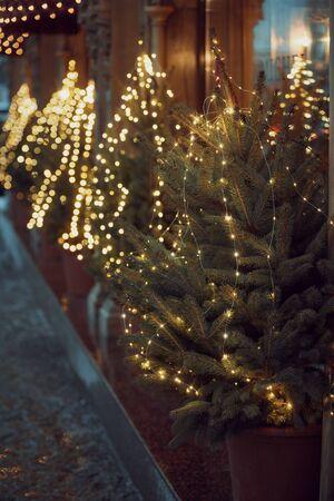 New Year lights Xmas Christmas tree decoration and festive Illumination. Defocused bokeh Background Effect.