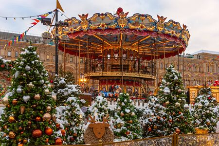 Christmas market at the Kremlin. Colorful carousels. New year. Holiday in the capital of Russia. Winter trip to Moscow.
