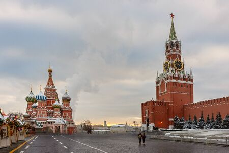 Moscow Kremlin and of St Basil's Cathedral on Red Square, Moscow, Russia. Ancient Moscow Kremlin is the main tourist attraction of city. Beautiful panoramic view of the heart of Moscow on winter cloudy day.