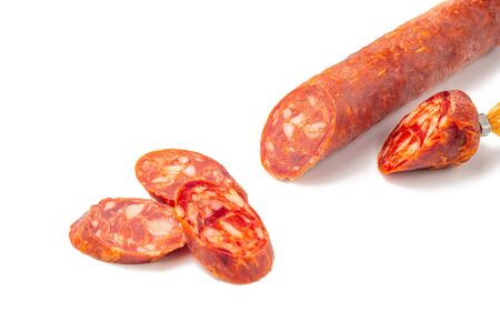 Fermented semi-dry, smoked sausage salami slices isolated on white background