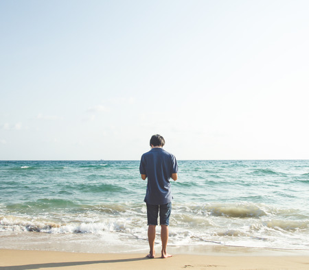 huahin: back of man on sea with color filtter Stock Photo