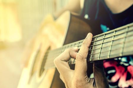 hand of man in classical guitar