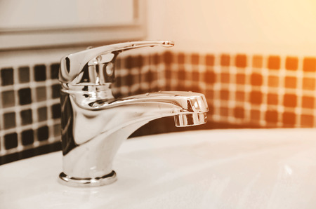 modern design faucet in rest room process in color filter Standard-Bild