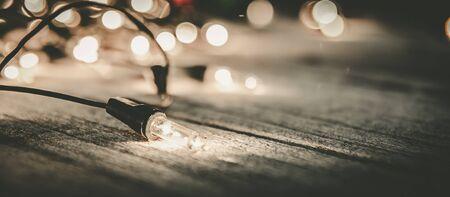 wood backgrounds: christmas light decor on wood background, color filter vintage tone