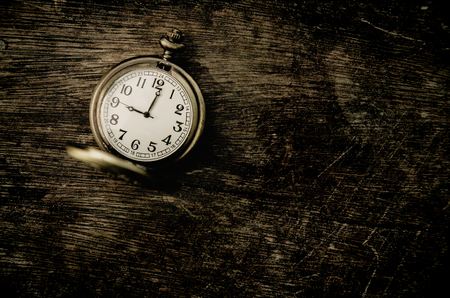 12 o clock: vintage pocket watch on grunge wood panel with copy space