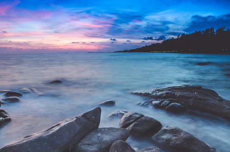 cloud scape: long exposure , Beautiful seascape sunset or sunrise at the sea with stone on Beautiful cloud scape moody sky at Rayong  , Thailand Stock Photo