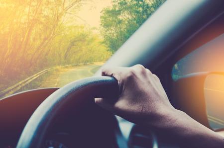 city limit: hand driving car
