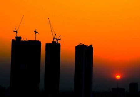 sillouette: sillouette construction site at sunrise time background