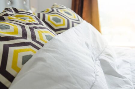 bed sheets and pillows messed up after nights sleep. Stock Photo