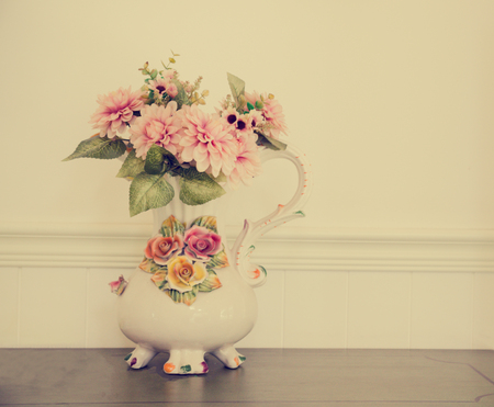 chabby: Vintage flower in a pot on a white wall Stock Photo