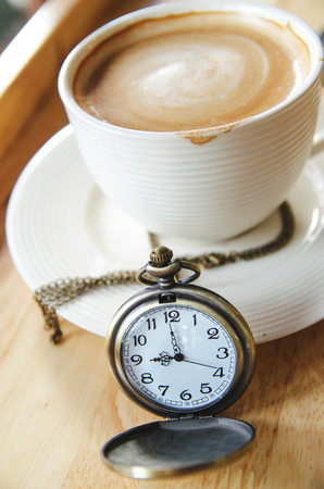 vintage pocket watch with coffee cup