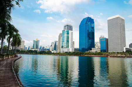 Landscape building modern business district of bangkok at twilgiht sky, beautiful water reflection.