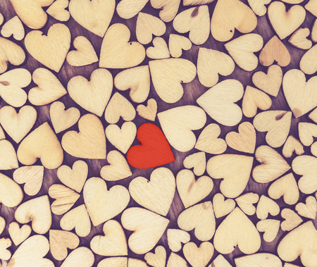 little wood heart  on wood background, valentine day concept with selective red heart  area , one love