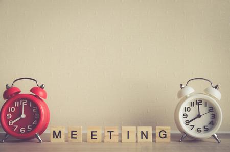 presentaion: MEETING word written on wood block