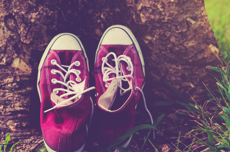 ingram: vintage retro red shoes , high-tops sneakers ,travel concept Stock Photo