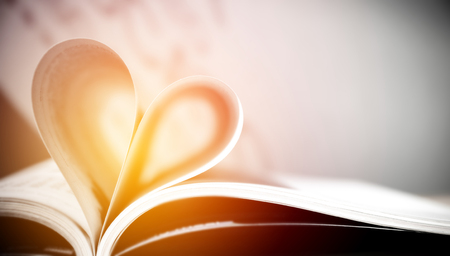 Pages of a book forming the shape of the heart. (love) ,valentine Stock fotó