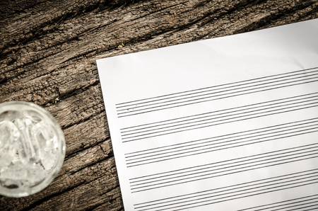musical score: music sheet on wood table