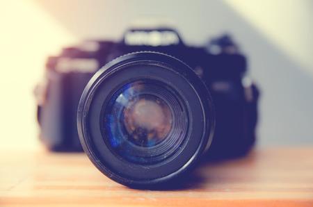 Retro camera on wooden table (camera, vintage) Stock fotó