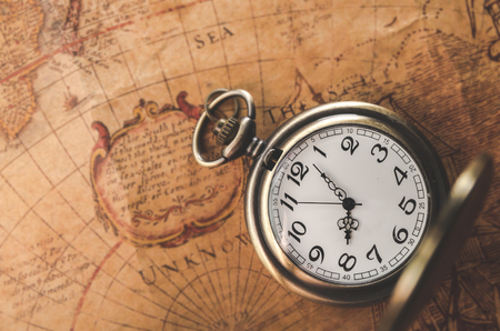Pocket watch or pendant watch on vintage map background watch pocket watch or pendant watch on vintage map background watch photo gumiabroncs Choice Image
