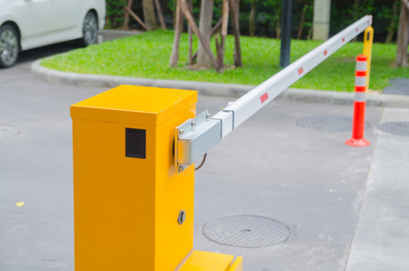 Security system for building access - barrier gate stop with toll booth, traffic cones and cctv