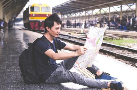 Asian man Traveler Backpack in main train station  City Concept Editöryel
