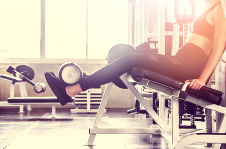 Woman exercise workout in gym fitness on machine
