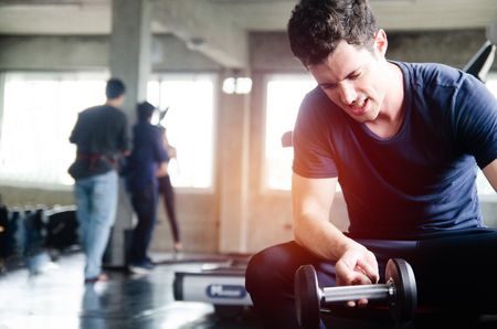 Bodybuilder working out with dumbbell weights at the gym Stok Fotoğraf