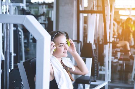 Young woman choosing music for sports training