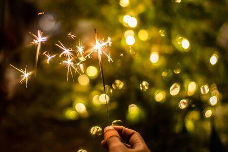 Christmas sparkler in girl hand