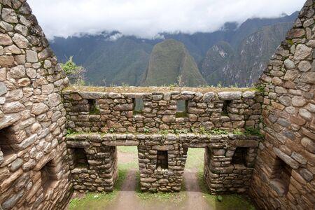 incan: Doors to mountain view in Machu Picchu ruins