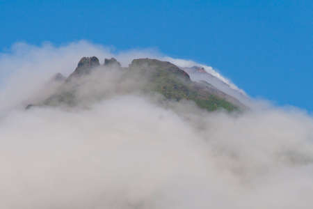 stratovolcano: Top of Arenal Volcano reaching above clouds, rainy season, Costa Rica
