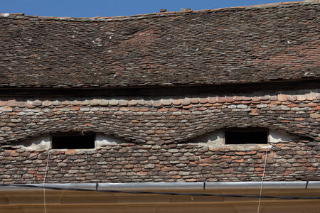 Eyebrow windows on tiled roofs in Hungary