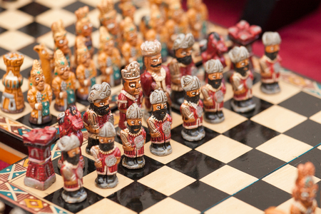 Minute chess figures lined up on a board, Sacred Valley, Peru Stok Fotoğraf