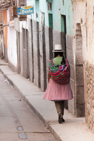 andean: Quechua woman walking the street of Calla, Peru in January 2010. Calla is a town in the famous Sacred Valley of the Incas near in the Peruvian Andes.