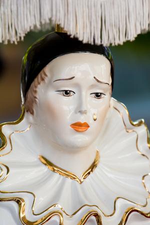 Vintage bedside lamp of sad Pierrot, famous pantomime Imagens
