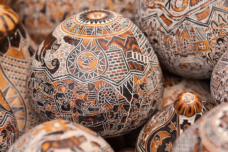 Intricate detail on hand crafted wooden eggs on market in Peru. South America Reklamní fotografie